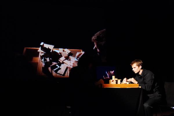 Table Setting, performance with Ali Momeni, 2008.  Image courtesy Reinout Heil.